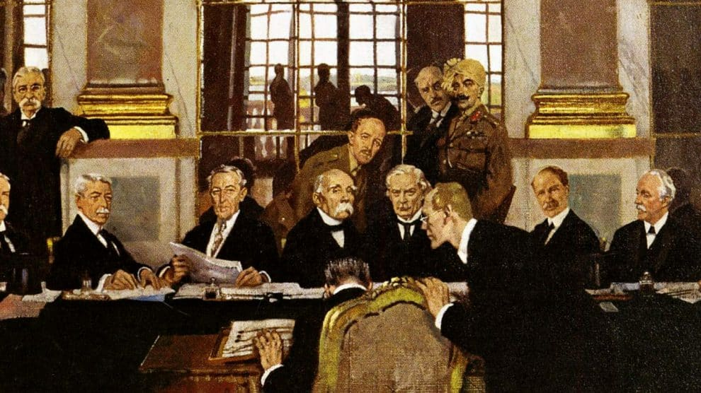William_Orpen_–_The_Signing_of_Peace_in_the_Hall_of_Mirrors_Versailles_1919_Ausschnitt-990x556
